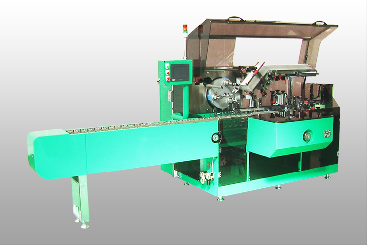 Horizontal continuous motion cartoning machine
